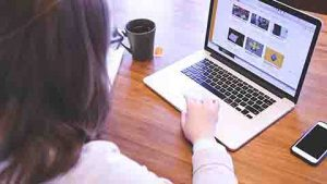 Online Marketing With Video. Shows laptop with website video.